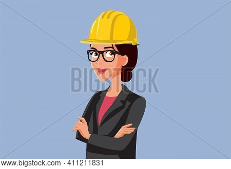 Female Contractor Wearing Hard Hat Standing With Arms Crossed