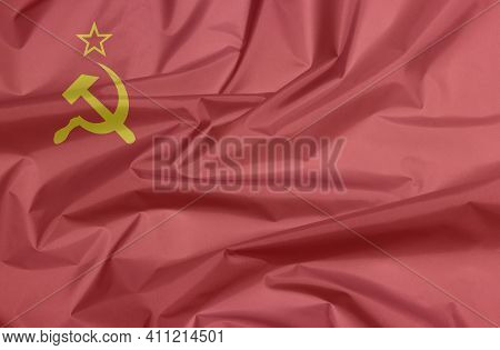 Fabric Flag Of Soviet Union. Crease Of The Hammer And Sickle Flag Background,  Red Flag With A Golde