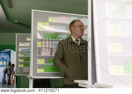 Lutsk, Volyn / Ukraine - April 13 2009: Man Posing Next To Bulletin Board At The Employment Center