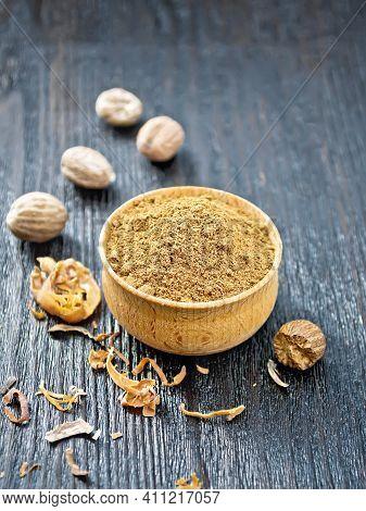 Nutmeg Round In Bowl On Black Board