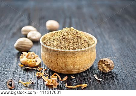 Nutmeg Round In Bowl On Wooden Board
