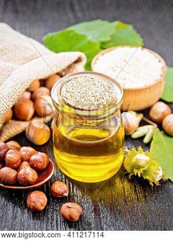 Oil Hazelnut In Jar On A Board