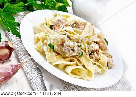 Pasta With Salmon And Cream On Light Board