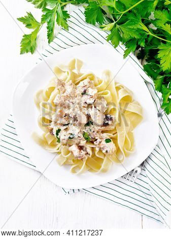 Pasta With Salmon In Cream On White Board Top
