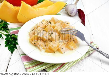 Pumpkin With Sour Cream Sauce In Plate On White Wooden Board