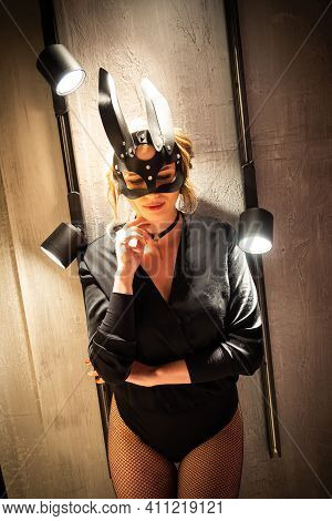 Sexy Woman In Black Underwear In Bdsm Bunny Leather Mask And Accessories. Posing On The Background O