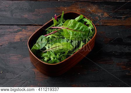 Herb Green Salad With Arugula And Mangold, Swiss Chard Set, On Old Dark  Wooden Table Background