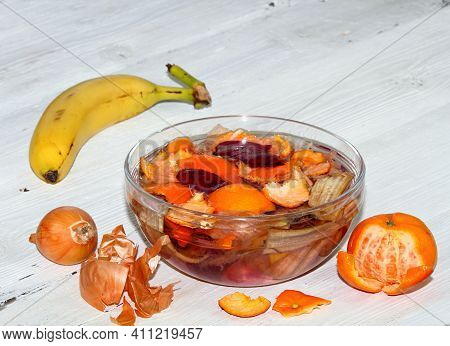 Eco Friendly And Cheap Way How To Fertilize Plants And Flowers Indoor. Peels Of Banana, Tangerine, O
