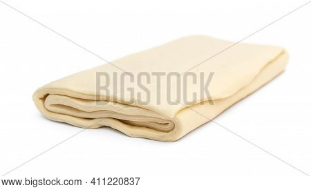Folded Raw Puff Dough On A White Background.
