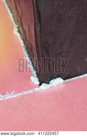 Construction Foam Between Pink Extruded Styrofoam Sheets