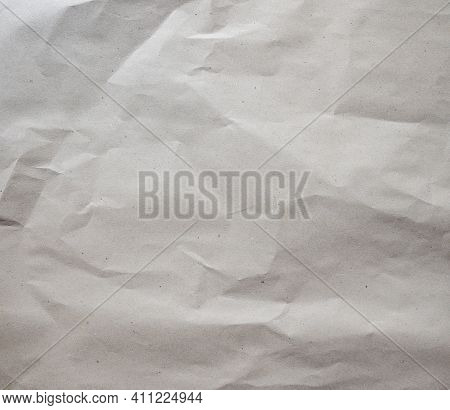 Crumpled Brown Paper Texture Background Of Paperboard Sheet