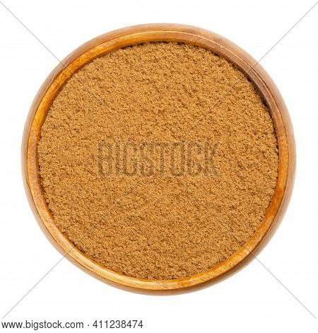 Ground Nutmeg In A Wooden Bowl. Powdered Nutmeg, Also Known As Fragrant Or True Nutmeg, Dried Seeds