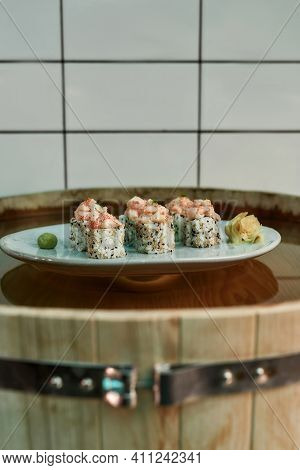 Healthy Sushi Food Is On The Table In A Restaurant. Rice With Fish Restaurant Food From Asia. Health