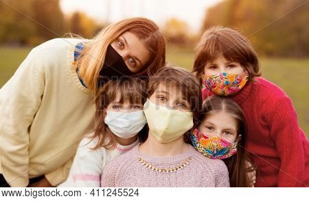 Group Of School Girlfriends Wearing Protective Masks Await End Of Pandemic Lockdown, Freedom And Bac