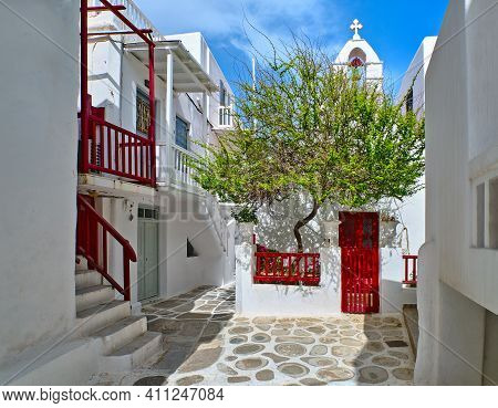 Beautiful Traditional Narrow Cobbled Streets, Small Squares Of Greek Island Towns. Whitewashed House
