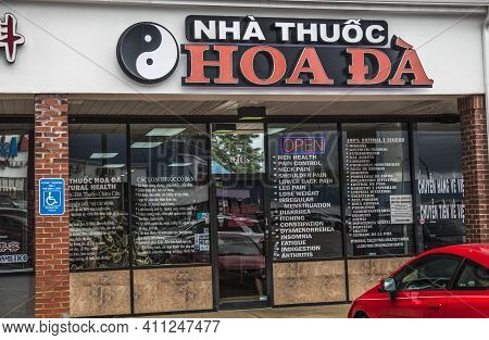 Doraville, Ga / Usa - 07 06 20: View Of An Asian Store Front With Text On The Windows And A Neon Ope