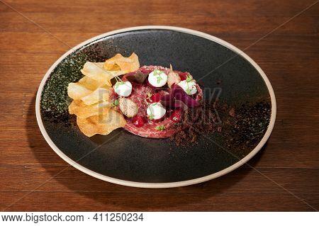Meat Tartare On Black Plate