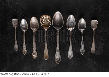 Silver Cutlery On Black Background.pile Of Vintage Silverware And Empty Plates On Dark Grey Backgrou