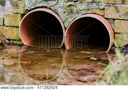 Sewers With Toxic Dirty Water From Metal Pipes. Draining Water From City Sewer. Environmental Pollut