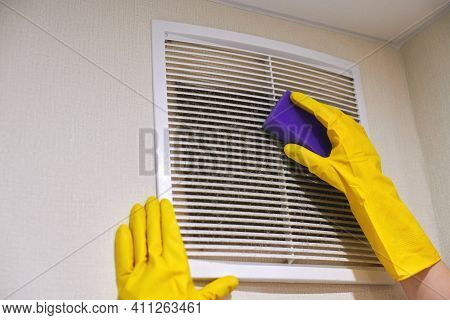 Hands In Protective Rubber Gloves Cleaning Dusty Air Ventilation Grill Of Hvac. Cleaning Service Con