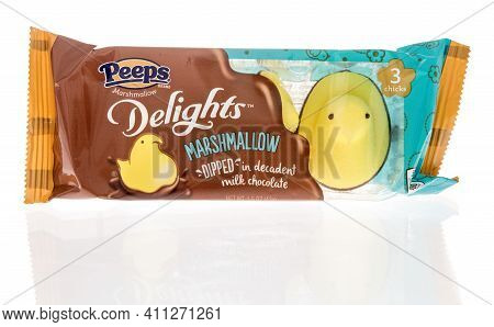 Winneconne, Wi - 4 March 2021: A Package Of Peeps Delights Dipped In Milk Chocolate Chicks On An Iso