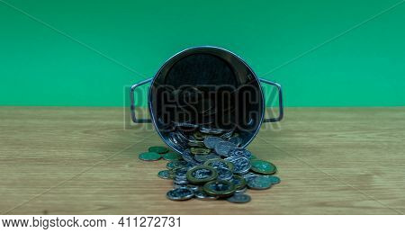 Singapore Dollar Silver Coins Spilling From Silver Pail. Isolated.