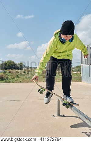 Young, Teenager, With A Skateboard, Jumping, On A Track, Skateboarding, Wearing Headphones