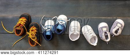 Baby Boy Blue Shoes Variety On Blue Color Background, Top View..