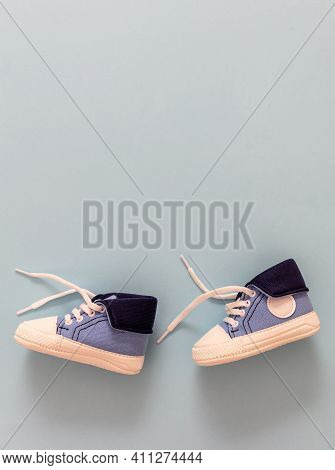 Baby Boy Shoes On Pastel Blue Color Background, Copy Space