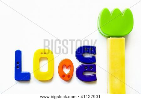 Love Made From  Plastic Buttons And Tulip Plastic Flower