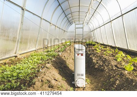 Heater In A Greenhouse, A Concept Of Maintaining The Required Temperature In A Greenhouse By Means O