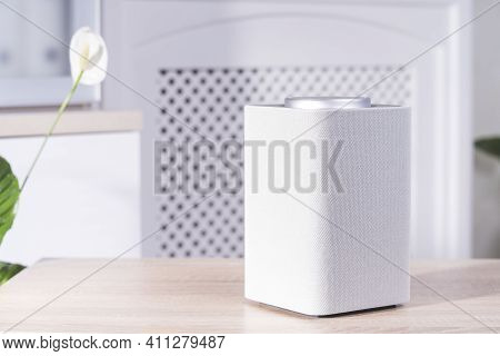 Smart Speaker On The Table In The Room, Gadget In The Apartment Close-up, Selective Focus, Tinted Im