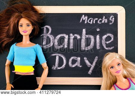 Tambov, Russian Federation - February 24, 2020 Two Barbie Dolls And Blackboard With Words Barbie Day