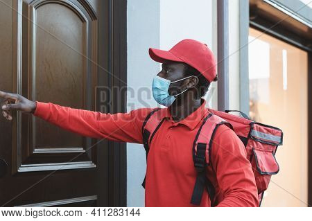 African Rider Man Delivering Meal To Customers Home While Wearing Face Mask During Corona Virus Outb