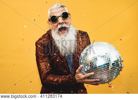 Crazy Senior Man Having Fun Doing Party During Holidays Time - Elderly People Celebrating Life Conce