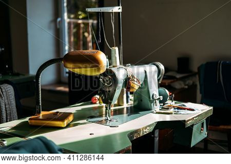 Sewing Machine On Table In Factory In Sun Light. Small Business, Fashion Designe, Tailor Working, Ca