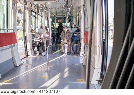 Kabatas, Istanbul, Turkey - 02.26.2021: Passengers With Mask Sit On Tram Seats Of Parked Turkish Tra