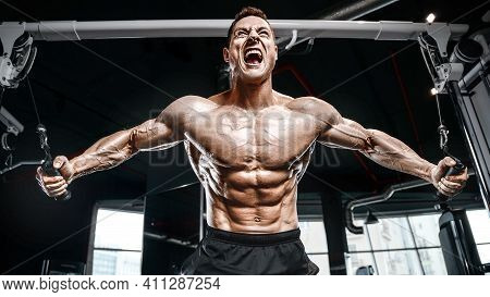 Brutal Strong Bodybuilder Athletic Man Pumping Up Muscles Workout Bodybuilding Concept Background -