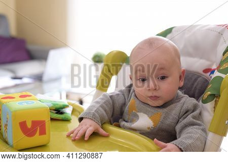 Baby Playing With His Toys While His Mother Telework From The Sofa At Home. Family Conciliation Conc