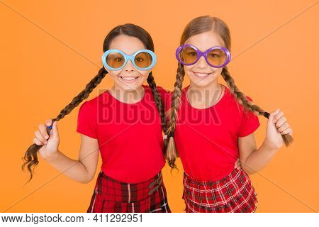 Party Style. School Prom Party. Red Fashion Girls. Happy Little Girls In Checkered Skirt. Stylish Ki