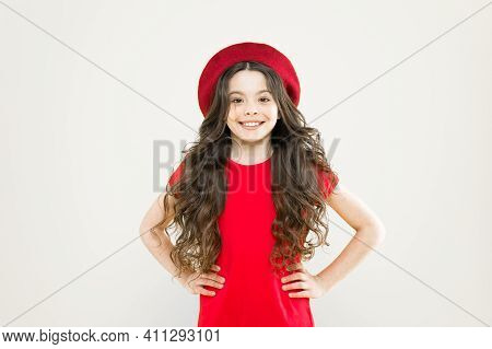 Following Her Personal Style. Little Girl In French Style Hat. Happy Girl With Long Curly Hair In Be