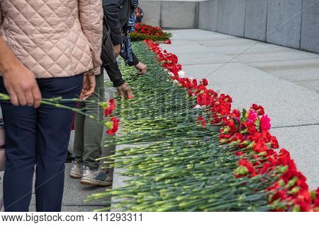 Red Flowers In Memory Of Victims In The World War On Victory Day On 9 May, Grave Of Unknown Soldier,