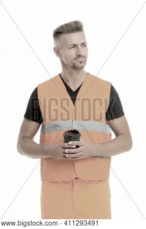 Coffee Break Concept. Builder Enjoy Coffee. Strong Handsome Builder Hold Coffee Cup. Successful Engi