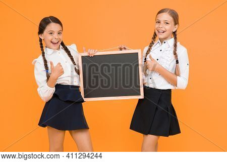 Check This Out. School Girls Cute Pupils Hold Blackboard Copy Space. Classmates Initiative Team Yell