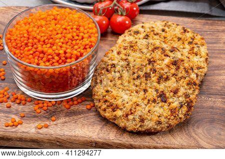 Healthy Vegetarian Or Vegan Food, Meat Free Burger Made From Orange Lentils Legumes