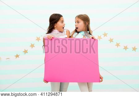 Shocking Announcement Concept. Amazing Surprising News. Girl Hold Advertising Banner. Girls Kids Hol
