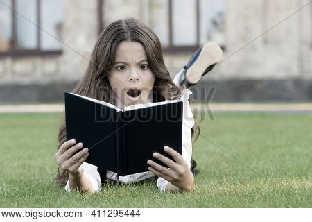 Extracurricular Reading. Cute Small Child Reading Book Outdoors. Basic Education. Adorable Little Gi