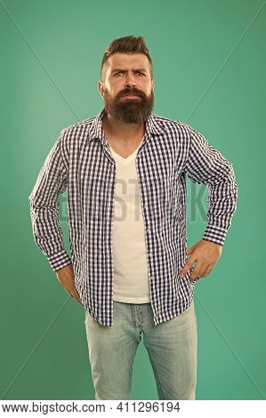 Will The Beard Stay In Fashion. Brutal Hipster With Beard Blue Background. Bearded Man In Casual Sty