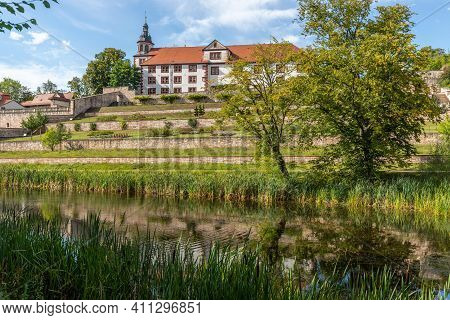 View Of Wilhelmsburg Castle In Schmalkalden, Thuringia With Park And Pond In The Foreground