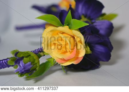 Beautiful Bright And Unforgettable Purple And Yellow Flowers On A Ukrainian Female Hair Band Located